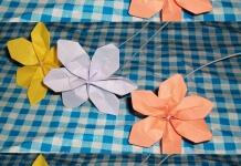 cómo hacer Flores de papel bond