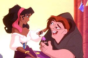 Quasimodo, the reclusive bell ringer of Notre Dame (R) meets Esmeralda, a Gypsy dancer as gargoyle p..